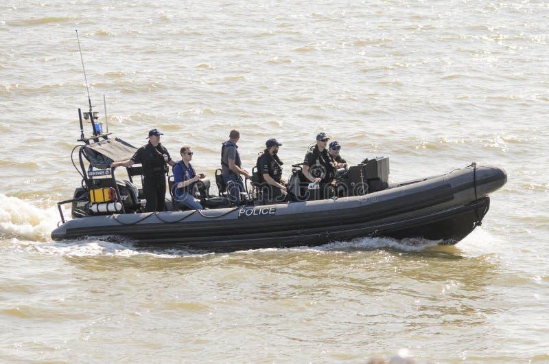 Police patrol boat patrolling out at sea UK stock image