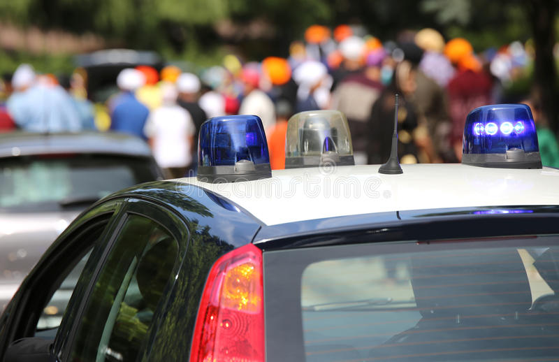 Police patrol cars flashing sirens. During the demonstration of people on the streets of the city royalty free stock photo