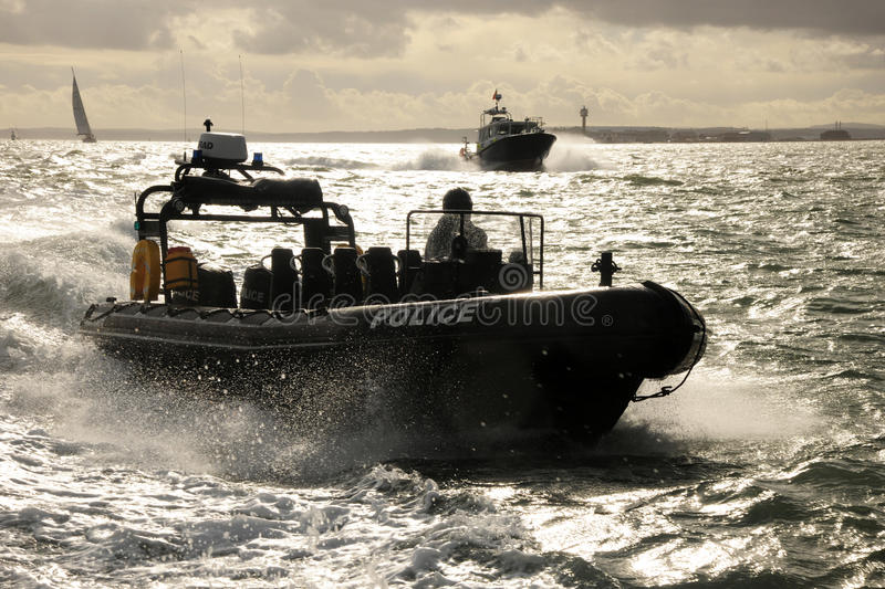 Police patrol RIB at speed stock images