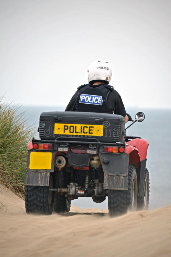 Police patrolling on quad bikes on the sands of Formby, United Kingdom stock photos