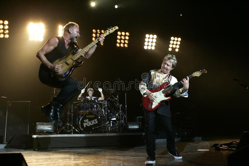 The Police Perform in Concert. Sting (L), Andy Summers (R) and Stewart Copeland (C) with The Police perform in concert at the Cruzan Amphitheatre in West Palm royalty free stock images