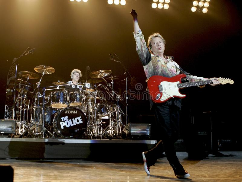 The Police performs in concert. Andy Summers R and Stewart Copeland with The Police perform in concert at the Cruzan Amphitheatre in West Palm Beach, Florida on stock photos