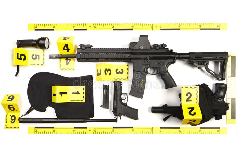 Police photo evidence of seized automatic gun and other weapons and contraband stock photos