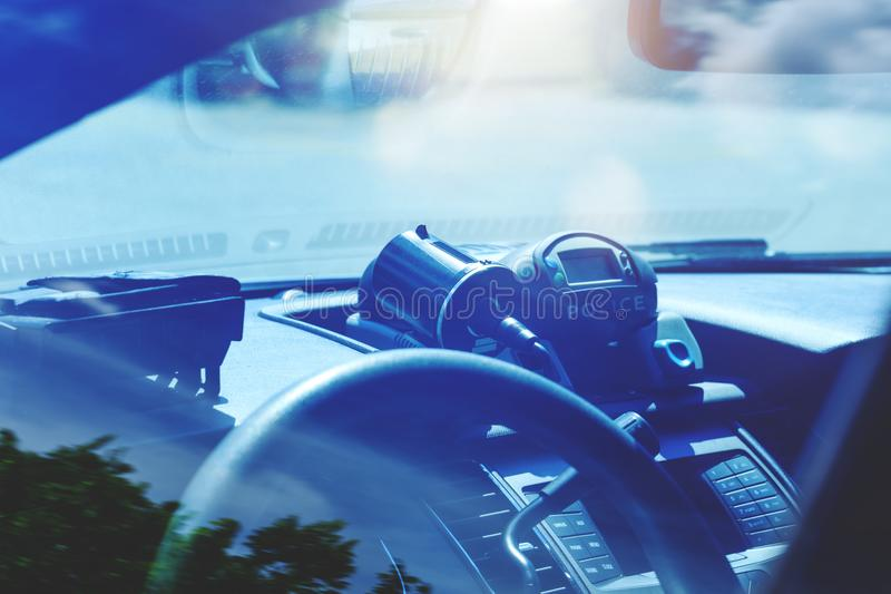 Police radar inside of police car. Patrol monitors traffic on a. Highway or on the roads of municipal district. Modern speed trap at a road. Policemen in the royalty free stock image