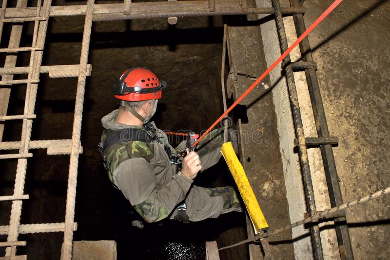 Police rescue worker runs the rope stock image