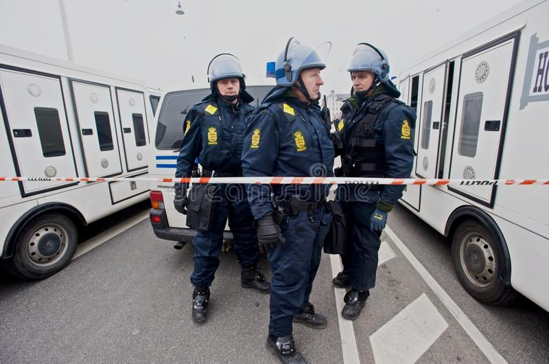 Police in Riot Gear. Police stand behind crime scene tape in riot gear during a climate change protest at the COP15 Climate Summit in Copenhagen, Denmark stock photo