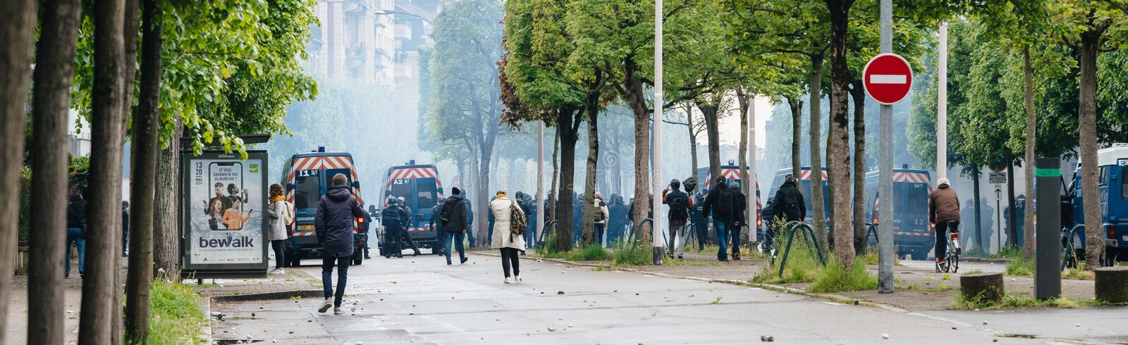 Police secure teargas near European Institutions during Yellow VEsts PRotest. Strasbourg, France - Apr 28, 2019: Wide image of Police securing European royalty free stock photos