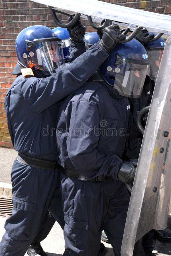 Police shield formation stock photography