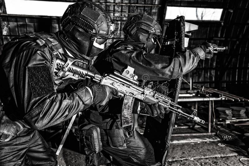Police special reaction team squad attacking criminals stock image