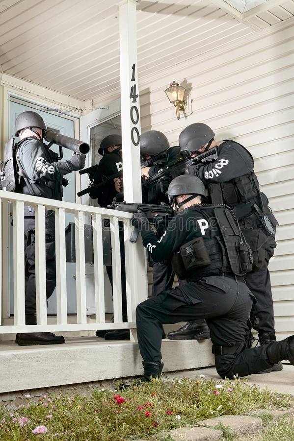 Police tactical team gathered round a house royalty free stock image