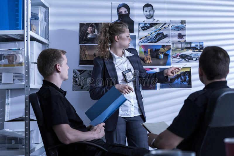 Police team during investigation stock photography