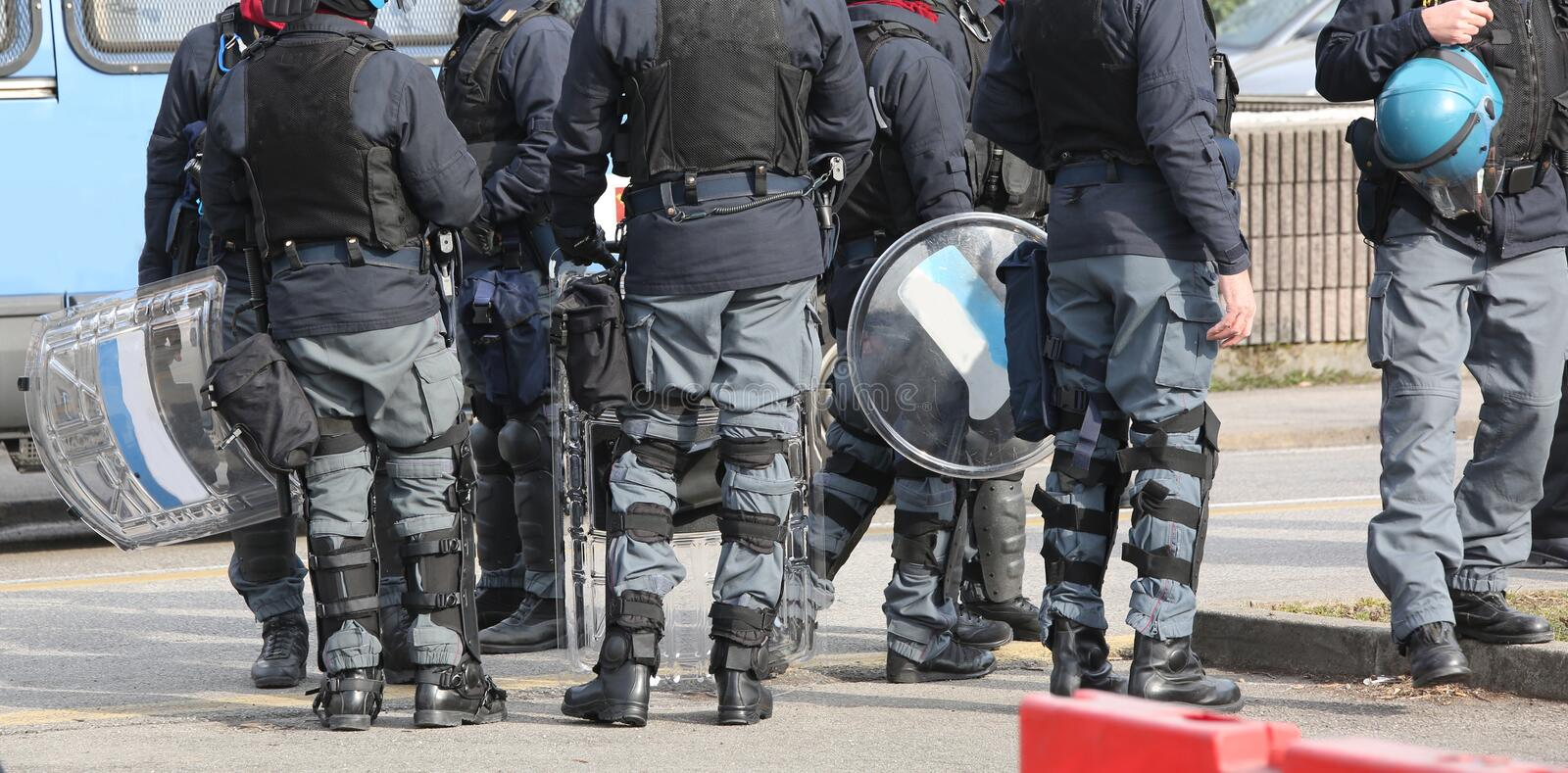 Police team in riot gear before the sport to avoid scuffles royalty free stock image