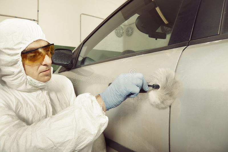 Police team working on criminal fingerprints on confiscated car royalty free stock images