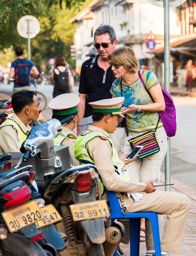 Police and tourists on the city street, Luang Prabang, Laos. Close-up. Police and tourists on the city street, Luang Prabang, Laos. Close-up stock image