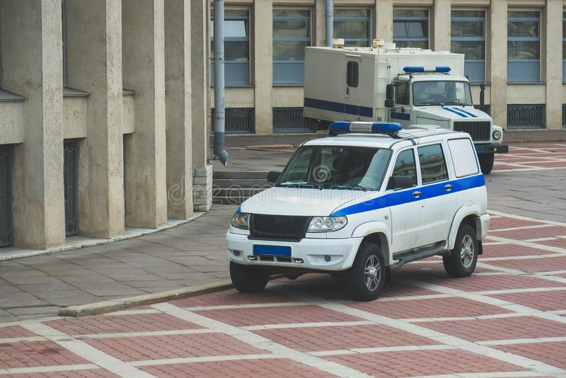 Police vehicle. Police vehicle and Prisoner transport vehicle standing near the courthouse in Russia stock photos