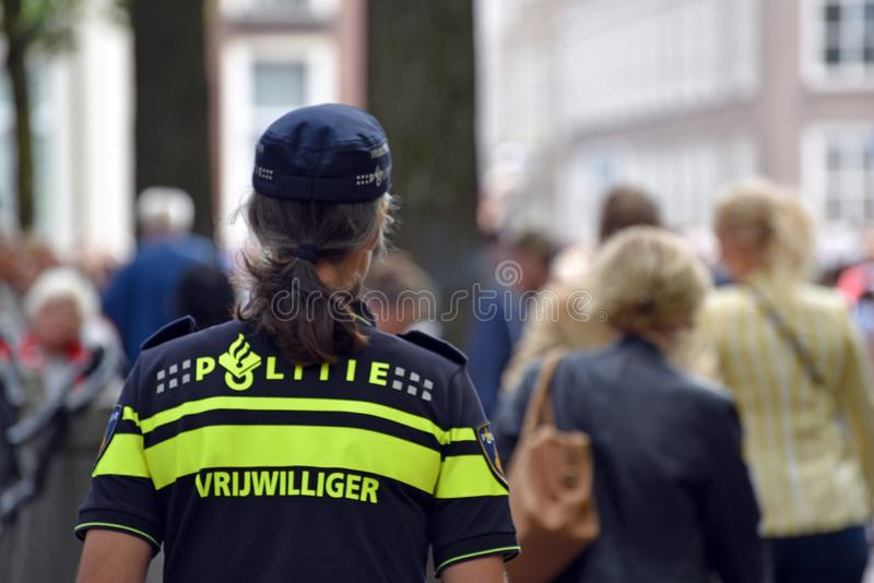 Police volunteer is watching the crowd stock photography