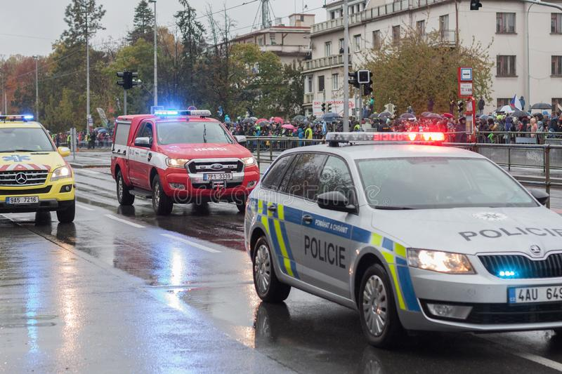 Police workers and Fire brigade workers riding cars on military parade royalty free stock photography