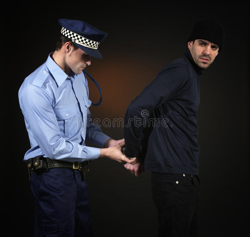 Free Policeman And Thief. Robbery Scene. Stock Images - 15884104