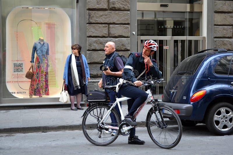 Policeman with bike stock photography