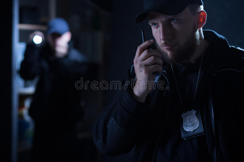 Policeman calling for back up. Photo of an policeman calling for back up on radio royalty free stock photos