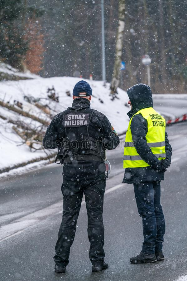 Policeman and civil guard on the road stock image