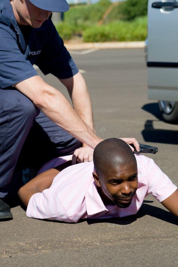 Policeman and criminal stock photos