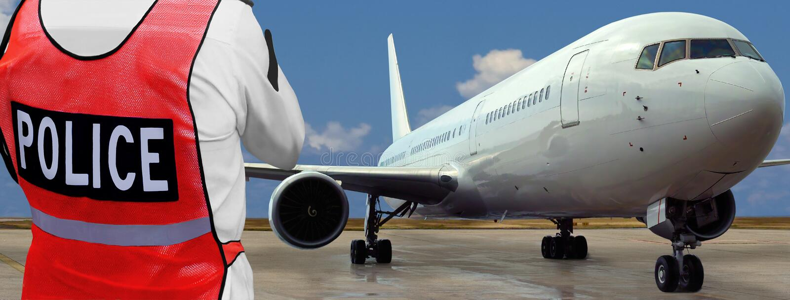 Policeman in front of airplane, airport stock photo