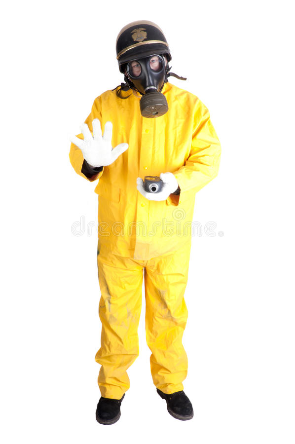 Policeman in Hazmat clothing with gieger counter royalty free stock images