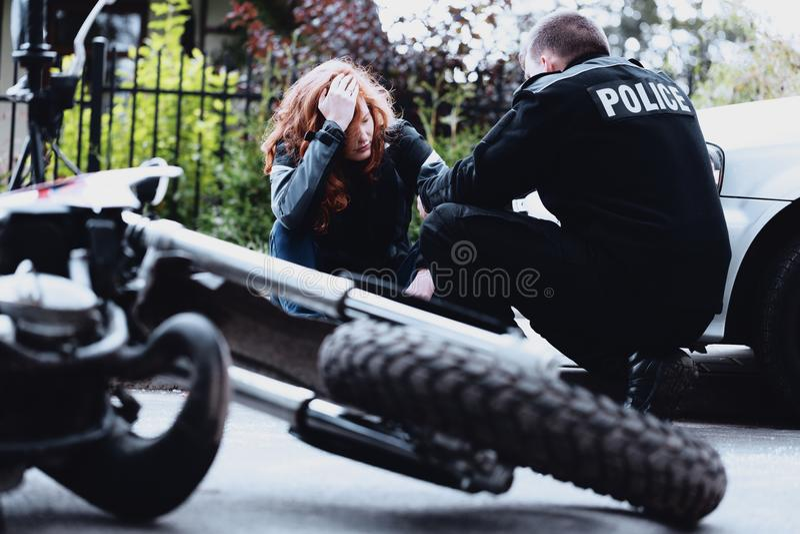 Policeman interviewing motorbike driver stock photos