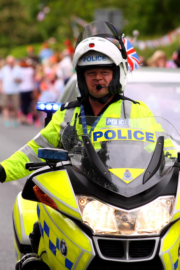 Policeman on motorbike 1. Photograph of a policeman on a motorbike at Olympic Torch Relay 2012 stock photography
