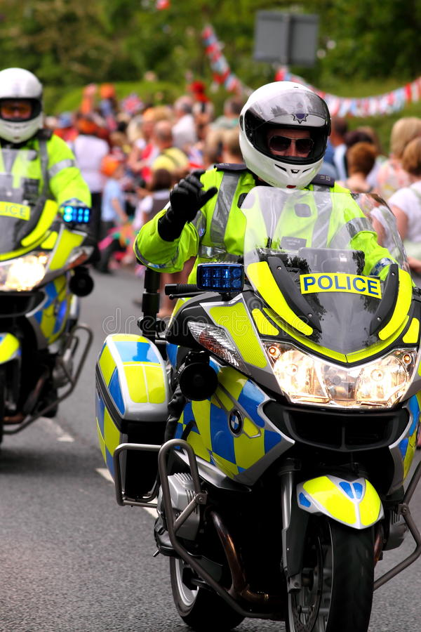 Policeman on motorbike 2. Photograph of a policeman on a motorbike controlling crowds at Olympic Torch Relay 2012 stock photography