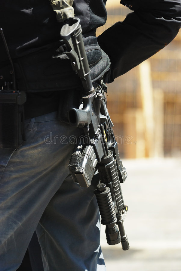 Policeman and rifle 3 royalty free stock image