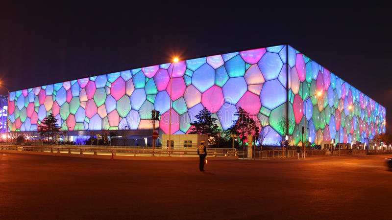 A policeman standing in front of the China National Swimming Center during APEC summit. A policeman standing in front of the China National Swimming Center ( stock images