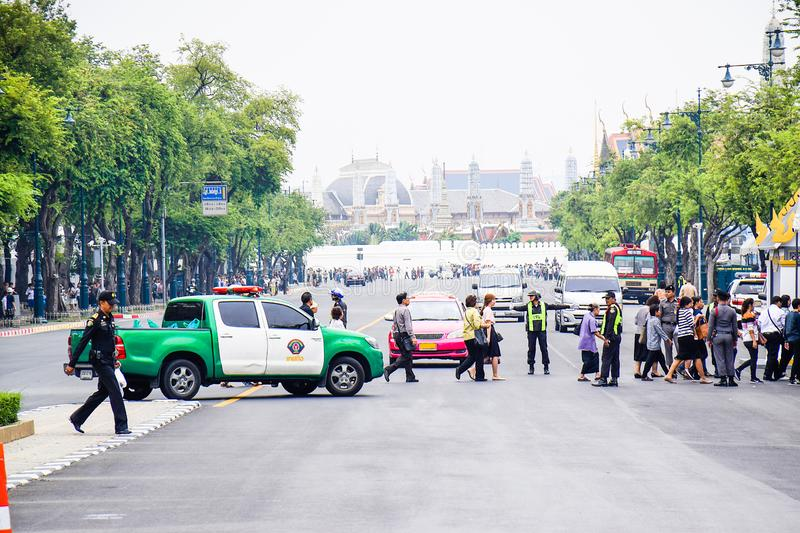 Policeman stop the cars for people crossing the road go to Sanam Luang Landmark, Bangkok Thailand. Background is royalty free stock photos