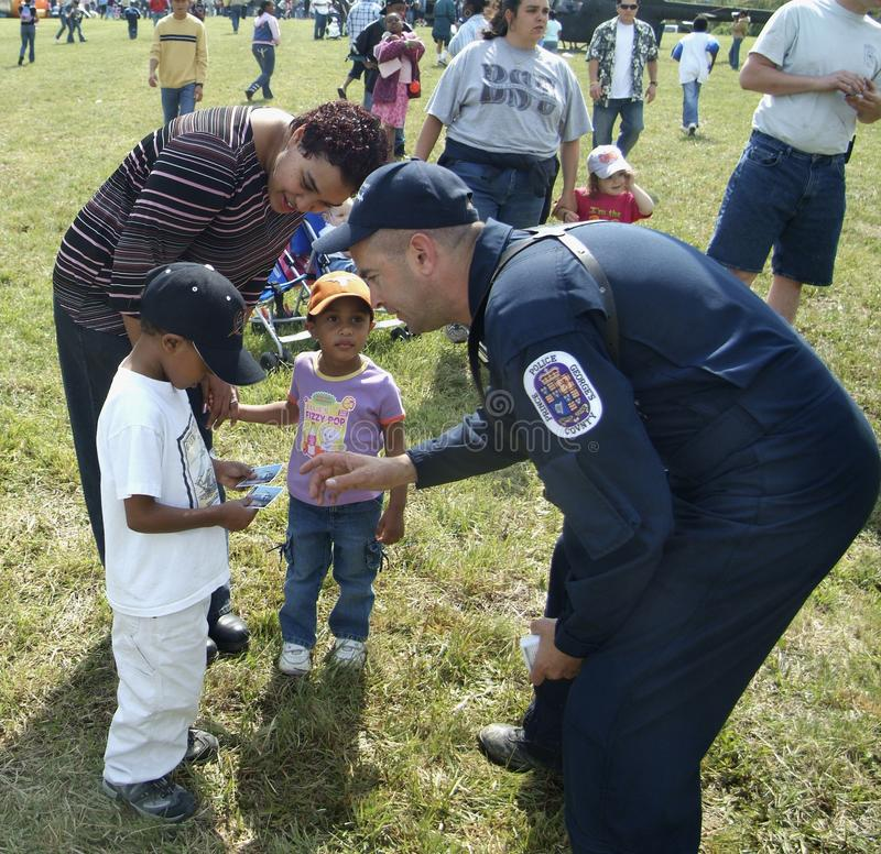 A policeman talks to little children. At a police display in Bowie, Maryland stock photo