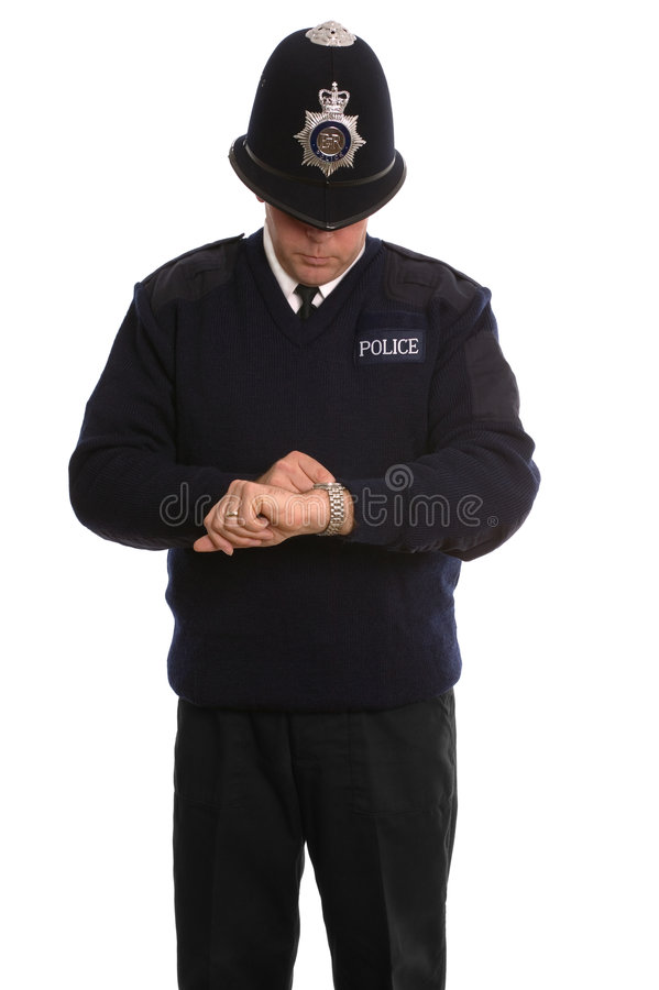 Policeman timecheck. royalty free stock images