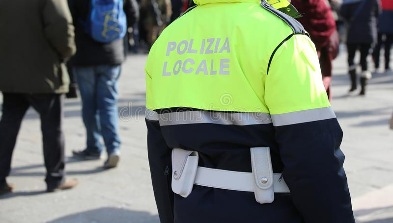 Policeman with uniform and the text POLIZIA LOCALE that meas Loc. Al Police in Italian language stock photo