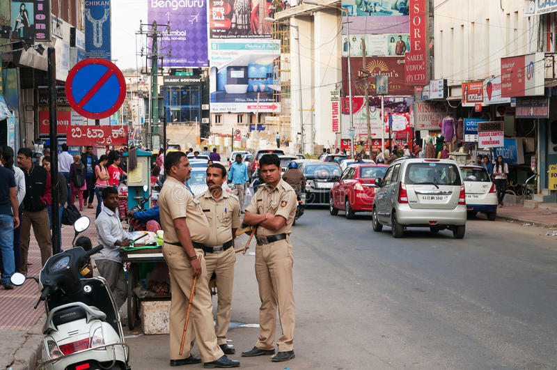 Policemen on Commercial street in Bangalore. BANGALORE, INDIA - DEC 25, 2014: Policemen on Commercial street. Commercial street in Bangalore is one of the main royalty free stock photo
