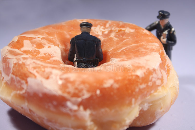 Policemen and donuts - comical royalty free stock image