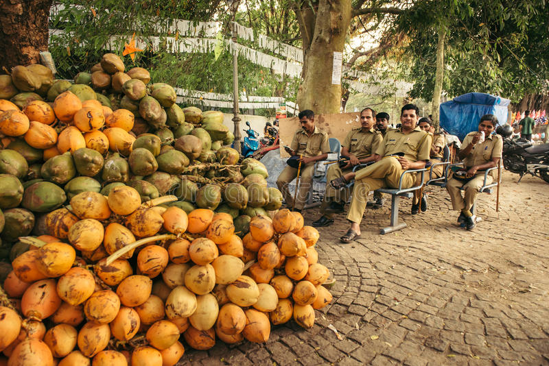 Policemen rest during a patrol in India. Kochi, India - December 5, 2015: Policemen rest during a patrol in the streets of Fort Kochi (Cochin), Kerala, India