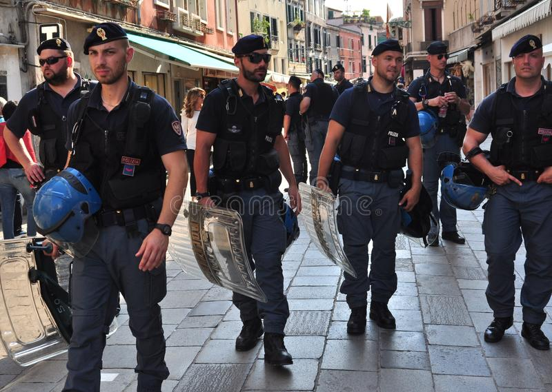 Policemen on the streets of Venice , Italy. The police are a constituted body of persons empowered by the state to enforce the law, protect property, and limit stock photography