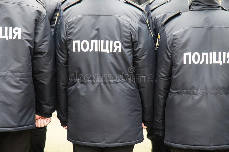 The policemen in uniform with the inscription Police in Ukrainian, stand the street in Dnipro city royalty free stock images