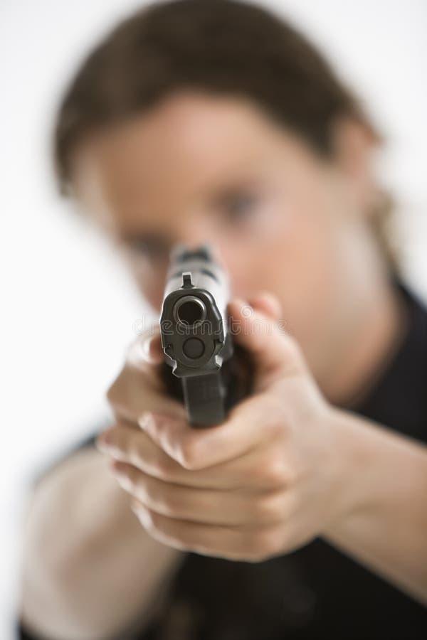 Policewoman aiming gun. royalty free stock photography