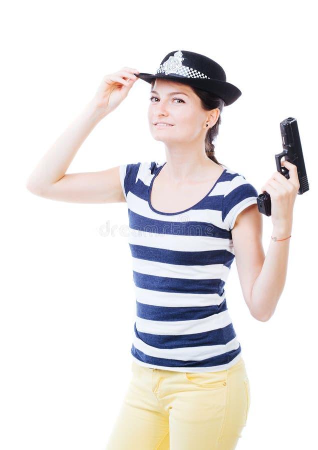 Policewoman with gun. Nice female holding a gun and posing as policewoman royalty free stock photos