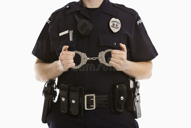 Policewoman with handcuffs. Close up of mid adult Caucasian policewoman holding locked handcuffs stock photography