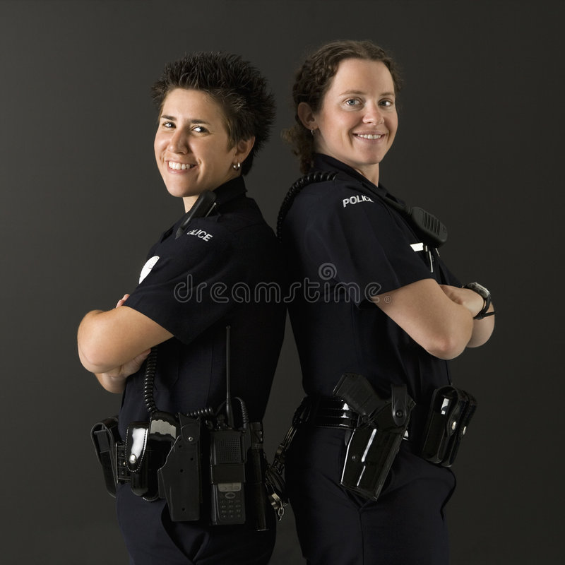 Policewomen back to back. stock photo