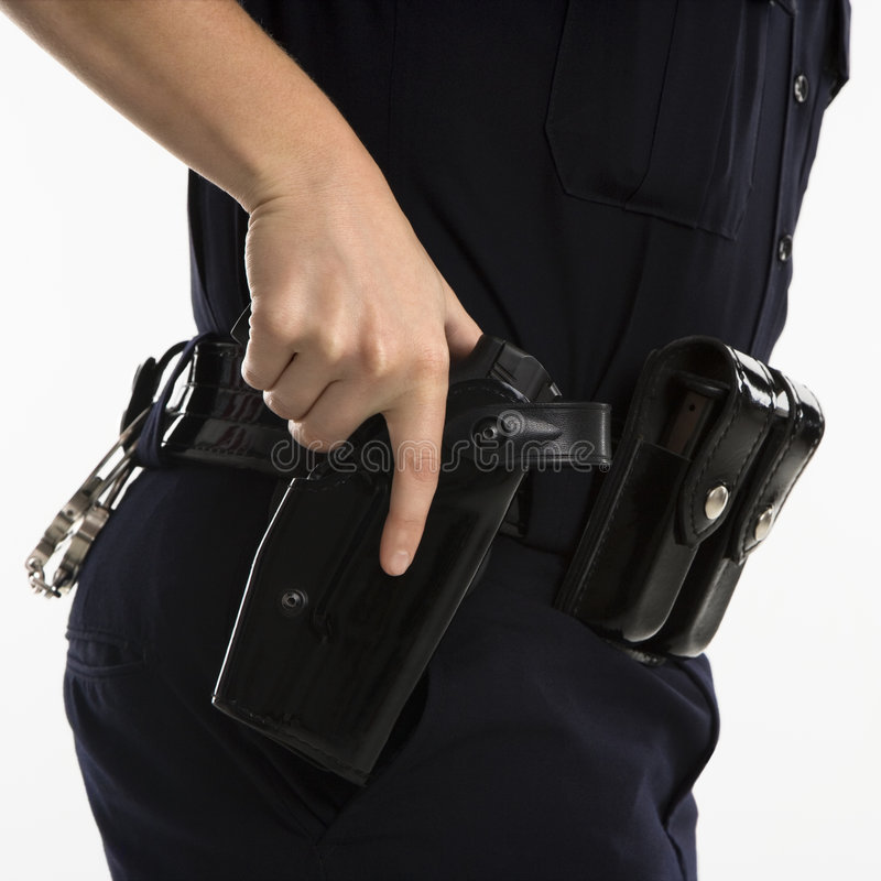 Policière armée. image libre de droits