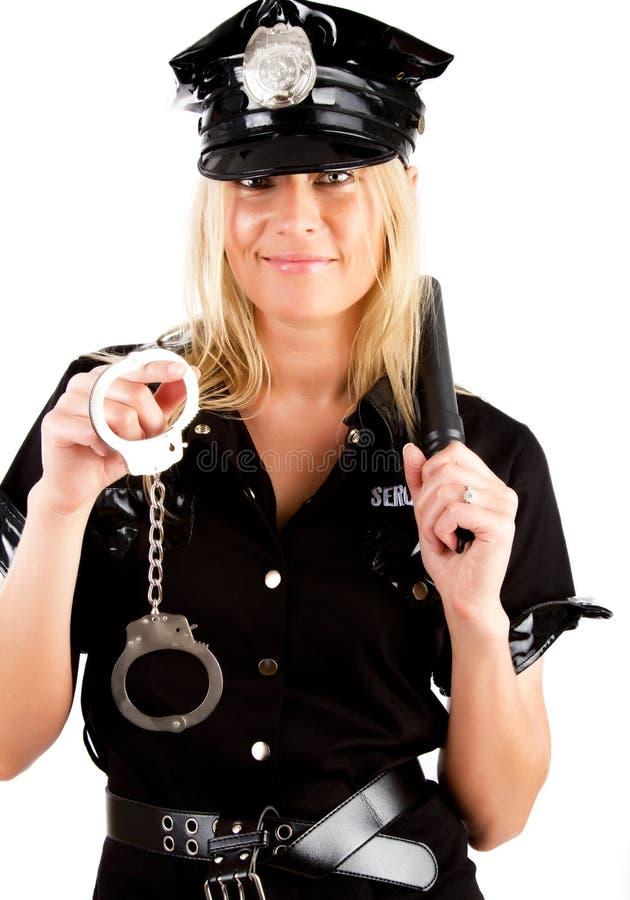 Policière retenant un bâton images libres de droits