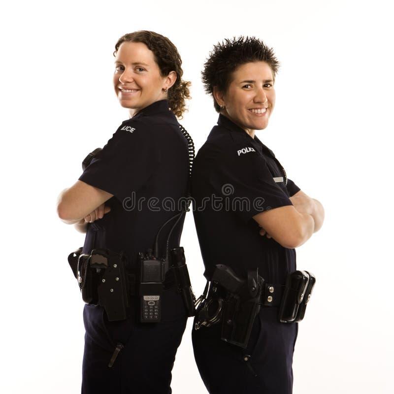 Policières de nouveau au dos. photo stock