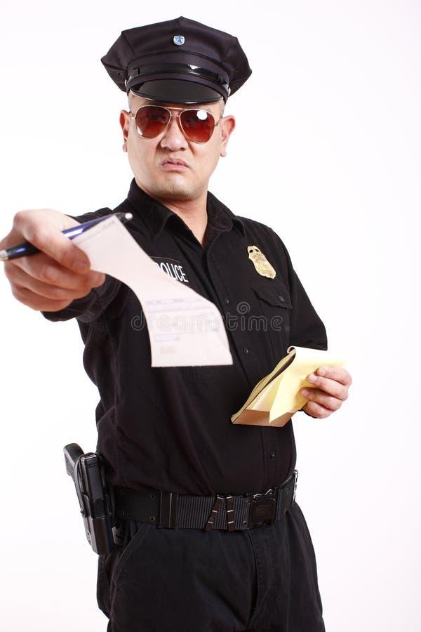 Policier donnant la citation photographie stock